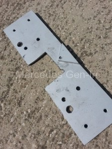 Spring compressor sadle plate