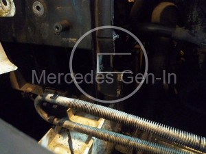 Left hand side front panel just above radiator locator fixing slot (25mm)